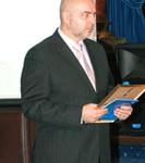 Александр Доброер принимает награду Европейской Бизнес Ассоциации